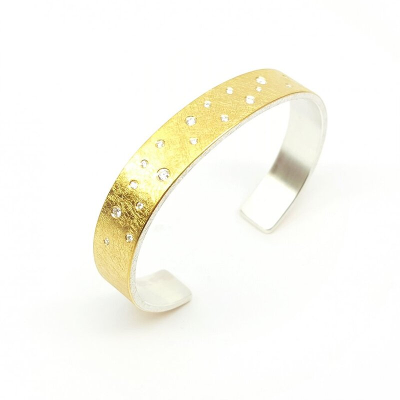 Bracelet en or jaune 22kt, argent 925-. et 21 brillants.
