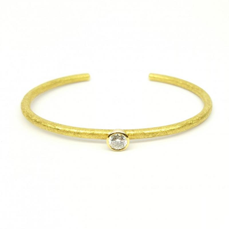 Bracelet en or jaune 18kt et brillant solitaire 0,50ct.